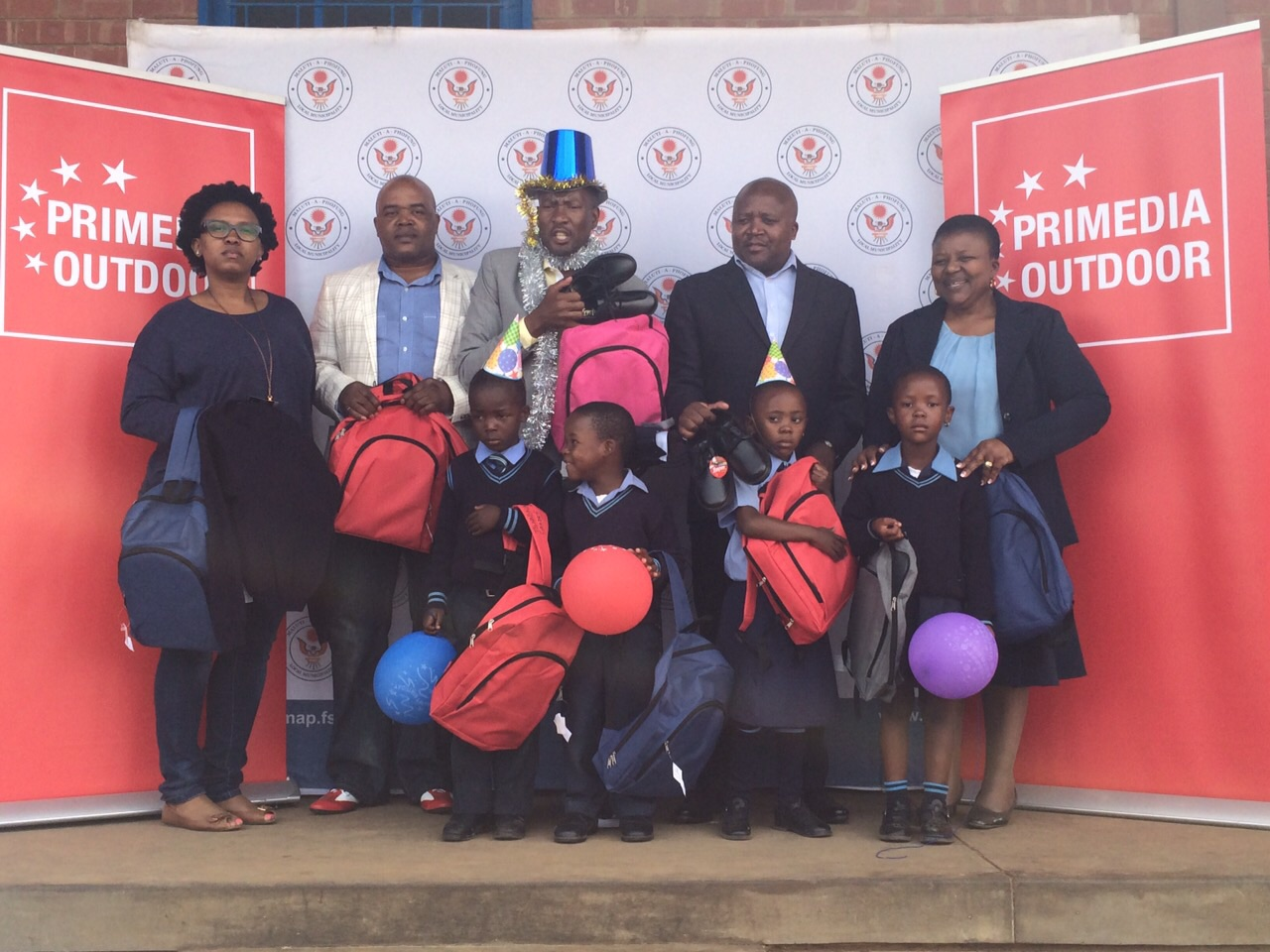 THE Maluti-a-Phofung Local Municipality's executive mayor, Vusi Tshabalala (middle), with representatives of Primedia Outdoor, the principal of the Sentebale Primary School and some of the beneficiaries. From the left are, front: Kanva Moloi, Karabo Xaba, Pontsho Dlamini, Ntsebeng Koma, Thato Hamaduna, Lebohang Mokubung and Montsheng Kgatla; back: Silindile Mafukleka (marketing services strategist, Primedia Outdoor), Simphiwe Sgongwe (account manager: development, Primedia Outdoor), Tshabalala,